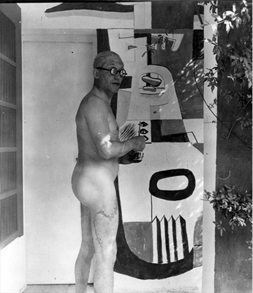 Le Corbusier painting a mural in E-1027 in 1939